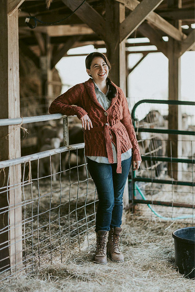 Christina Danaee is designing her current Appalachian Knits project with wool from Bovidae Farm (in background) in Mars Hill. photo by Olive & West Photography