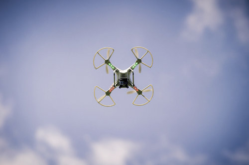 Researchers use a camera-equipped drone to survey the site from above.