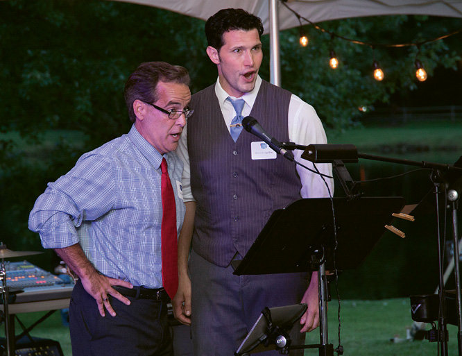 Actors Dr. Bill Martin and Dominic Aquillino performed a song from the musical The Denim King: The Moses Cone Story.