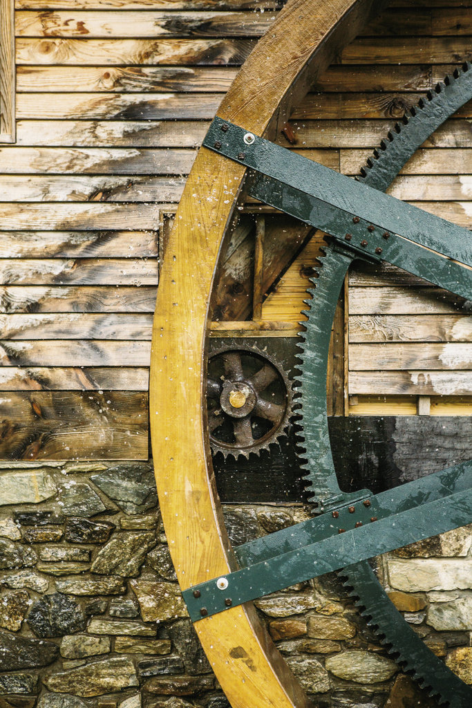 Corn comes out the chute and into a truck before being transported to the millhouse, which is powered the old-timey way by a waterwheel