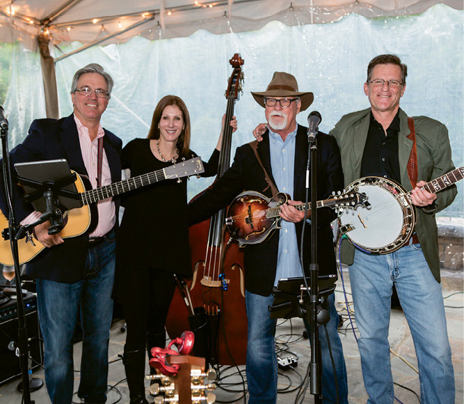 Wellstrung bluegrass band entertained guests during Stock Your Cellars tasting and market.