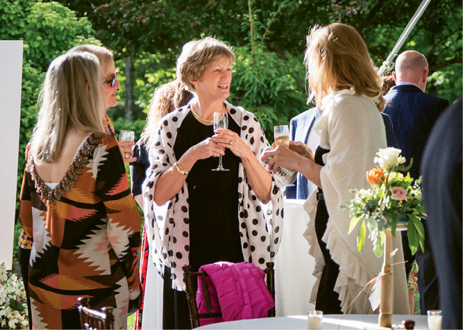 Elizabeth Fletcher and friends mingled during one of 12 winemaker dinners on Thursday.