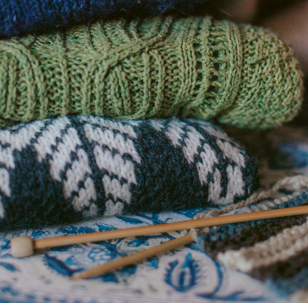 "Danaee makes and sells sweater patterns, including a Norwegian-inspired ""Ishav"" pattern (middle)."