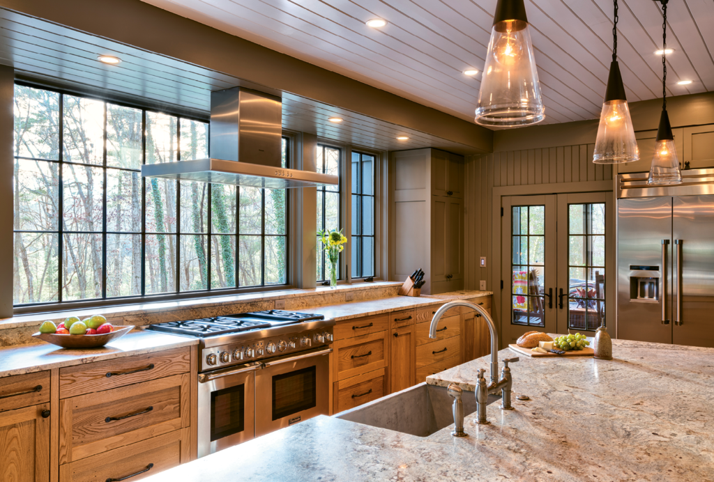 The kitchen remodel to update and add square footage was extensive. In an effort to keep some of the home's historical integrity, original chestnut paneling was repurposed to build the lower cabinetry.
