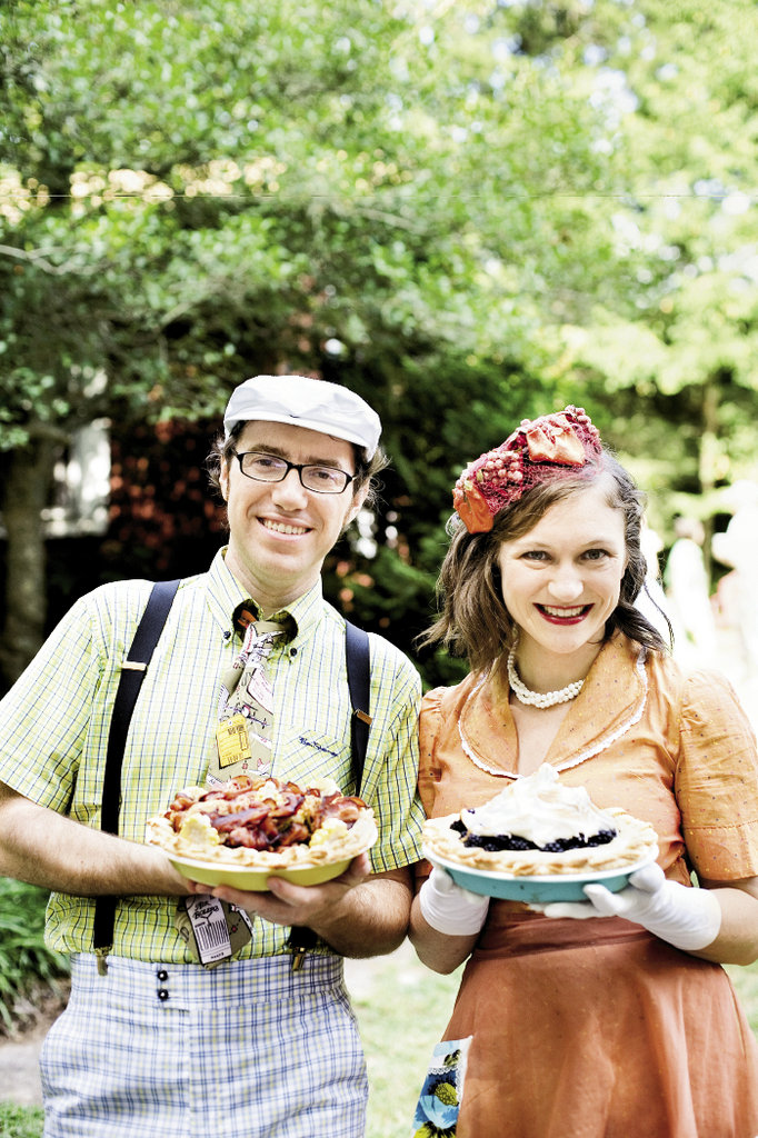 The couple's daughter, Annie Erbsen, and her husband, Gianluca De Bacco, show off their winning pies.
