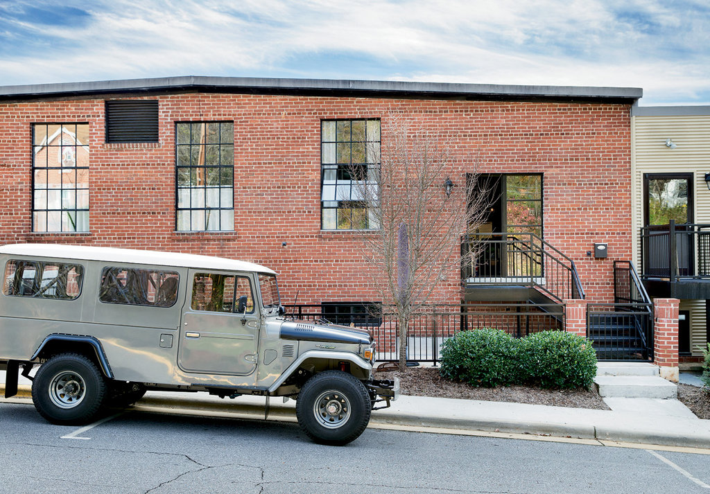 The 1979 Toyota Land Cruiser Hodge restored and retrofitted to seat four is often parked in front of his North Wilkesboro condo.