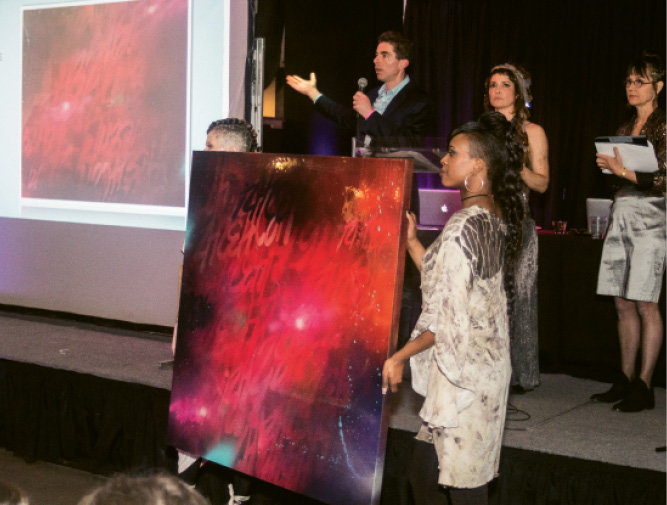 "Andrew Brunk auctioned off a painting  donated by Oscar ""Trek6"" Montes."