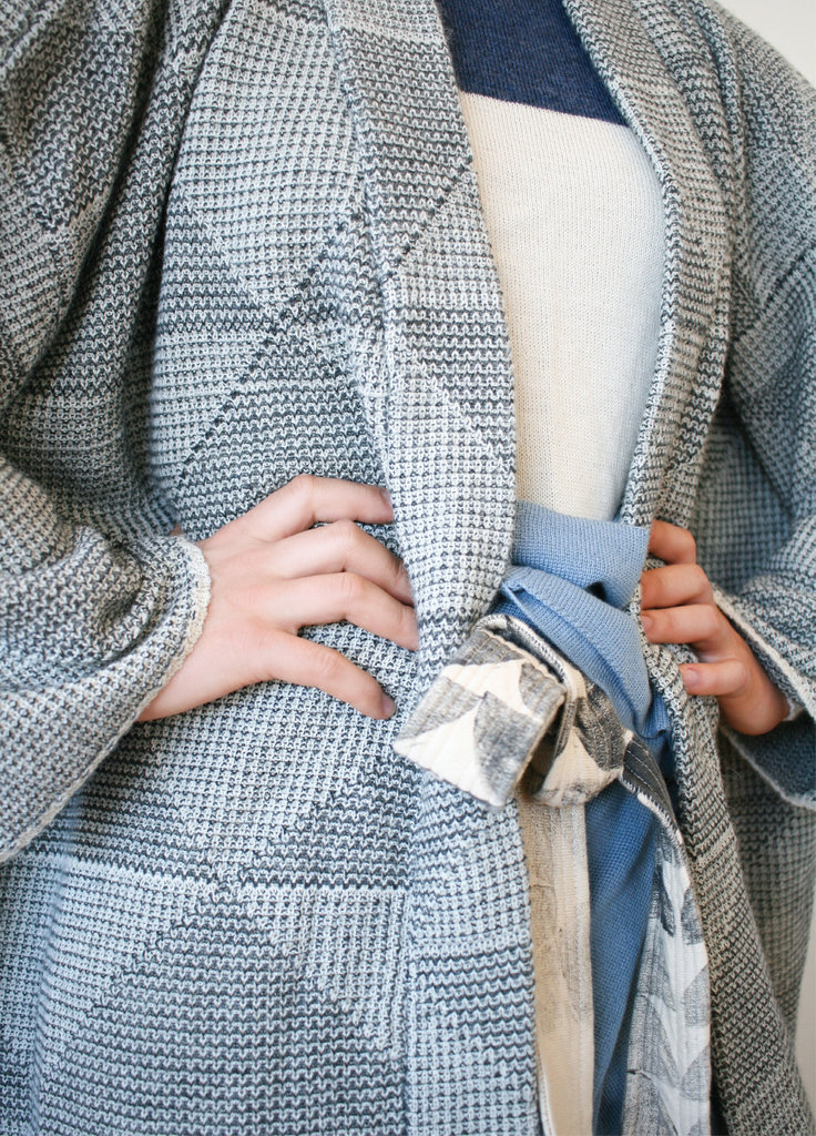 Inspired by the texture of tweed, Ansusinha's super soft, oversized cardigan is made with baby alpaca wool. Here, she pairs it with an alpaca top and block-print wrap pants inspired by those worn by Thai fishermen.