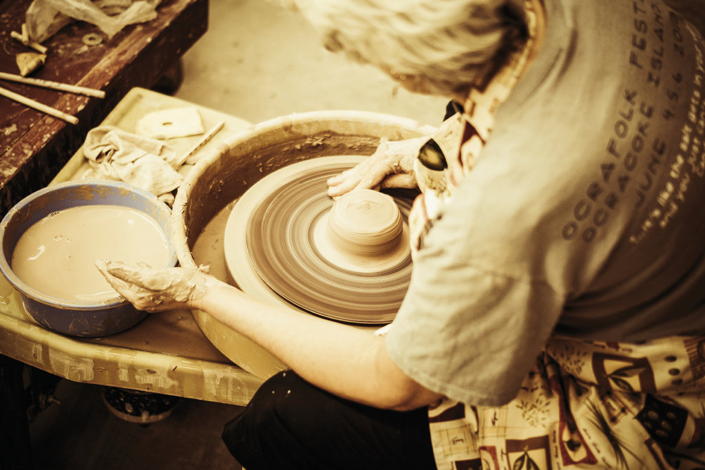 Working the wheel in the pottery studio