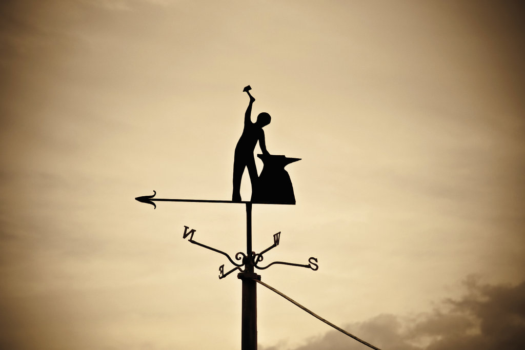 Metalwork across campus, such  as a weather vane atop the  Blacksmith Shop, highlights  the traditional skills in practice