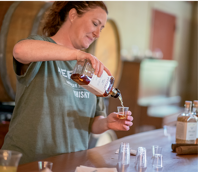 Defiant Whiskey employees provided tastings and information.