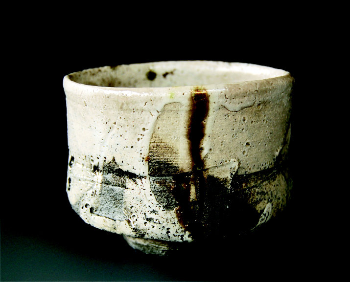 Many pieces, including the wood-fired chawan tea bowl, are thrown off center to give them an organic, hand-built quality.