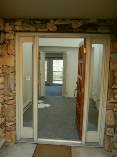 Before shot of the entry, located on the lower level