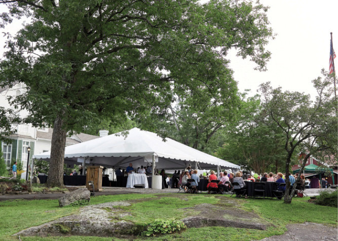 """Guests dined outdoors pre-show, with offerings laid out at the catering tent on """"the rock."""""""