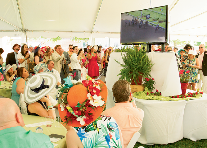 Attendees crowded around the big screen to watch the Kentucky Derby.