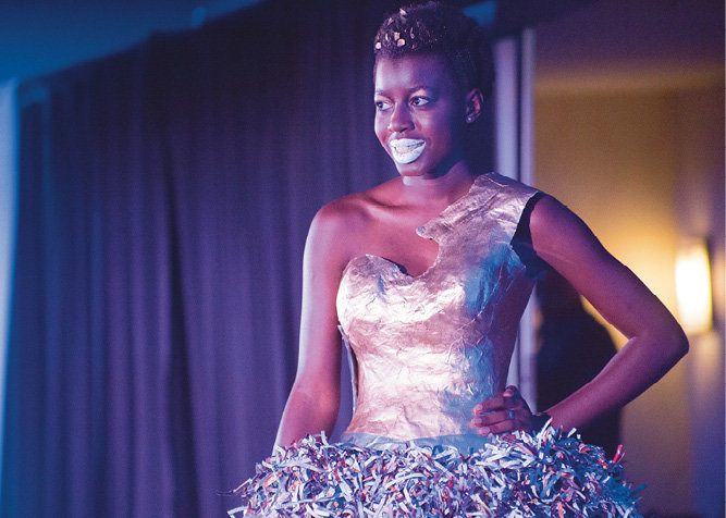 Nachele Johnson modeled her own dress in the Paper category.