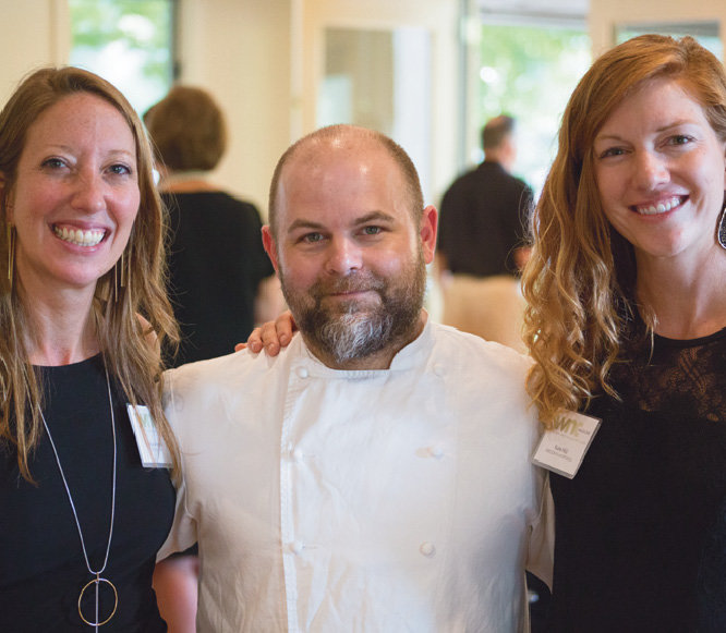WNC staffers Melissa Reardon (left) and Katie Hild (right) with Chef Jaime Hernandez