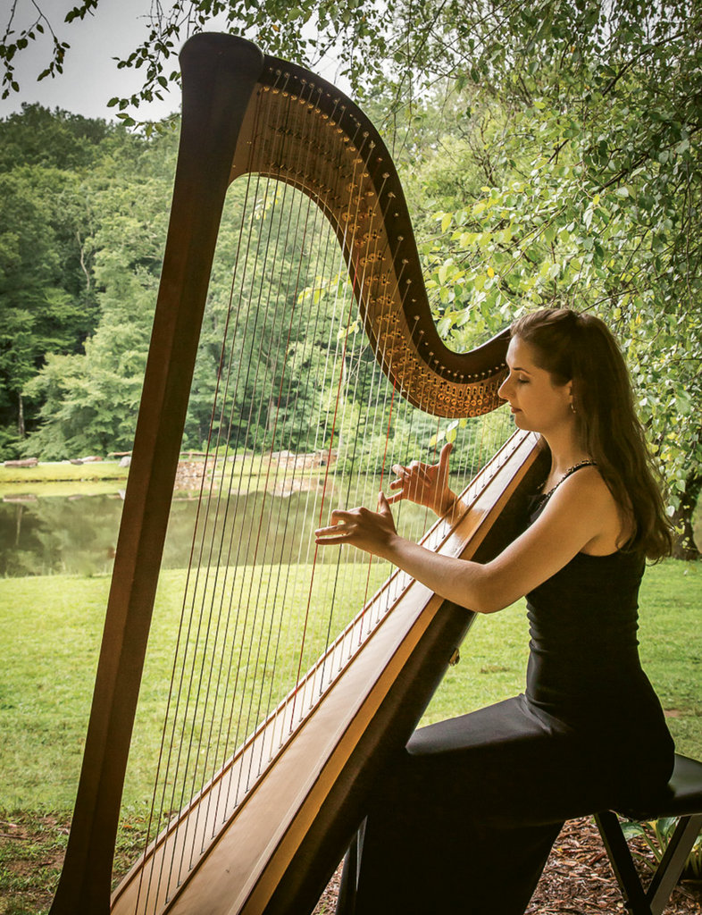 Natural Wonder: BMC's 180-acre wooded campus offers an inspiring setting for students like harpist Anna Weigandt.