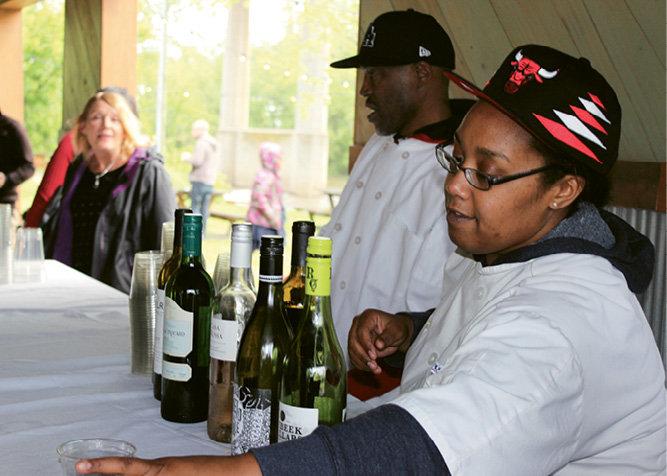 GO Kitchen Ready graduates Guy Stivender and Tashema Brown served wine.