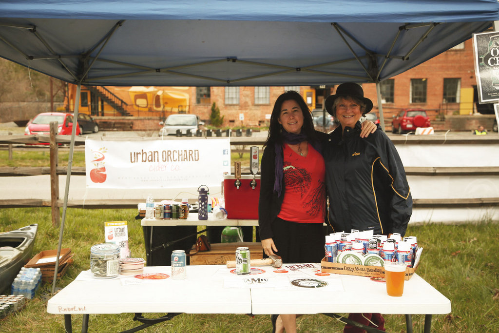 Brantlee Eisenman and Meg Bruch sold local brews and cider at the festival on Saturday.
