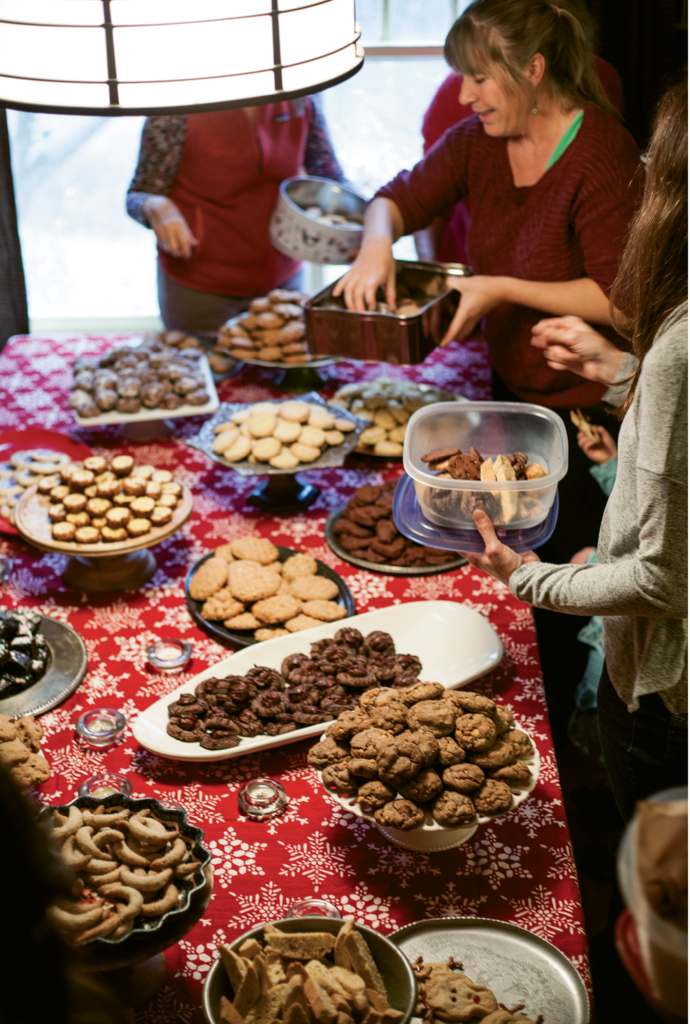 A Joyful Table: English lays out platters and cake stands for guests to display their cookies, so the spread looks as good as it tastes. When the party ends, guests are invited to take home several of each treat to enjoy and share throughout the holidays.