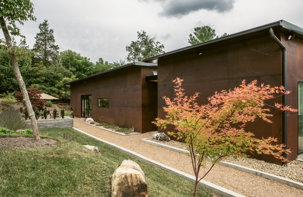 The corten steel siding will weather to a color that matches the earth.