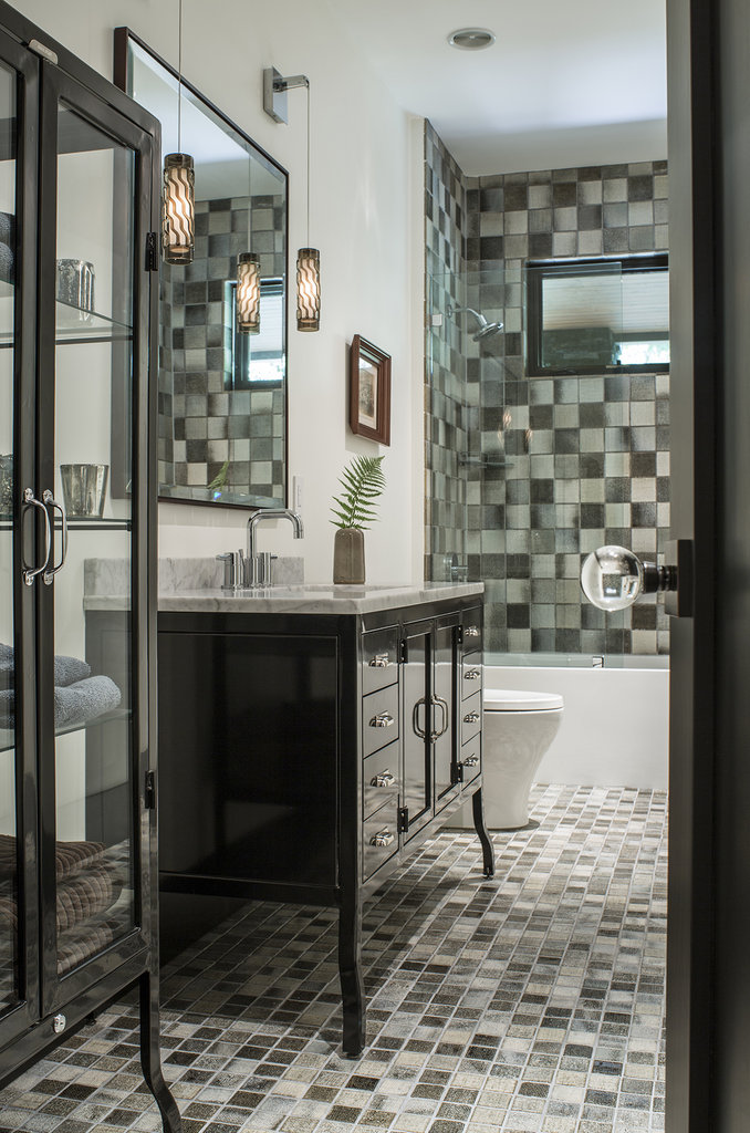 A downstairs guest bathroom features linen-textured handmade tiles from Japan.