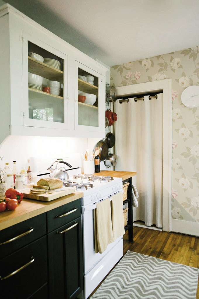 The kitchen sports a rescued and refinished cabinet and butcher-block countertops from Ikea.
