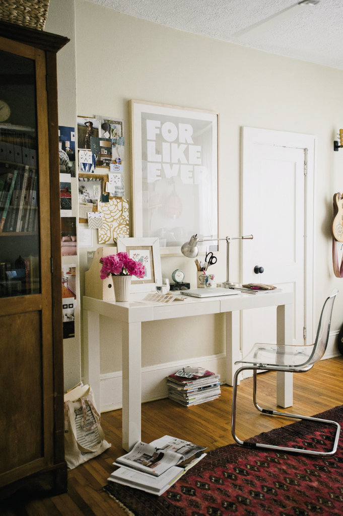The office serves as a den of creativity, housing Maria's design station and Bill's guitars.