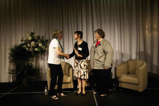 Jeannie Eblen (left) congratulated Eliada Homes staff Tami Ruckman and Nora Scheff.