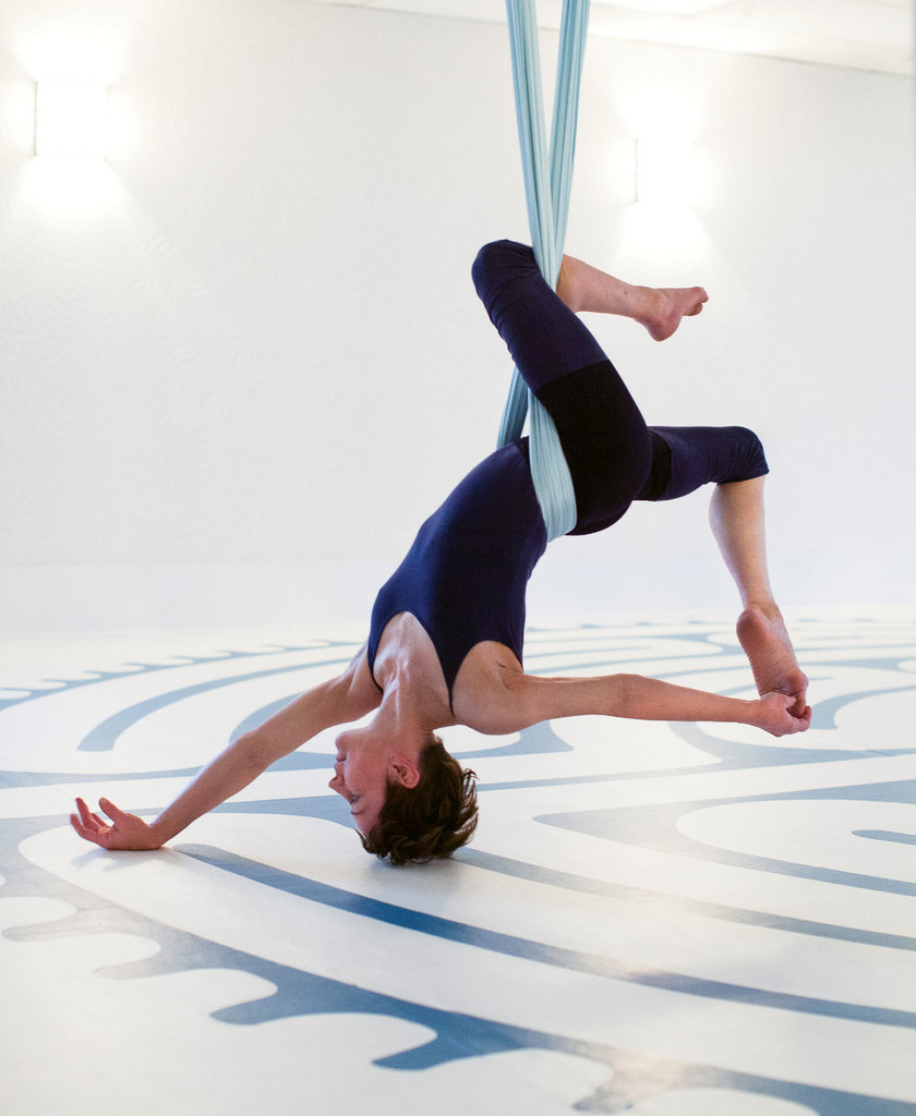 Blue De Leeuw teaches aerial arts and aerial yoga at The Shift in Hendersonville (shown), River Arts Ballet in Fletcher, and at Asheville Aerial Space. The activity builds strength and flexibility and boosts mental health.