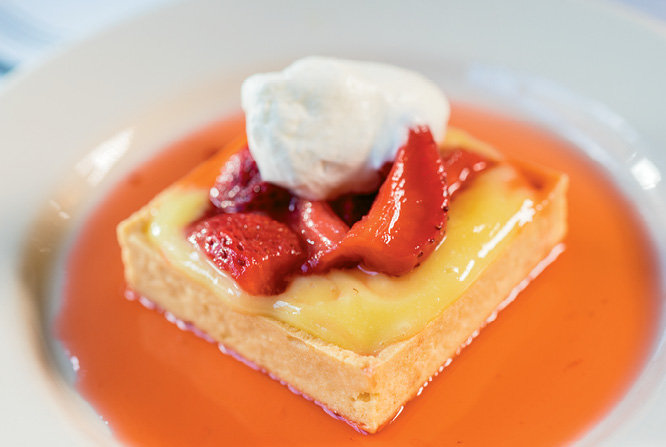 Desserts, like the house favorite lemon curd with strawberries are worth saving room for