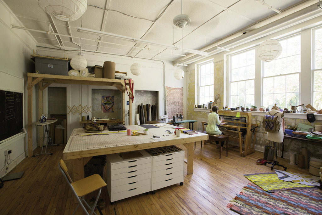 When the old Marshall High School was saved from the wrecking ball in 2007 and converted into artist studios, it spurred a cultural and business revival in downtown Marshall. Textile designer Amber Jensen is among the community of creators now taking up residence.