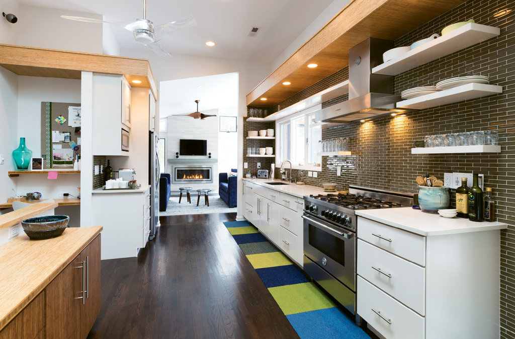 The kitchen is now bright and sleek thanks to skylights, a raised ceiling, and modern amenities.