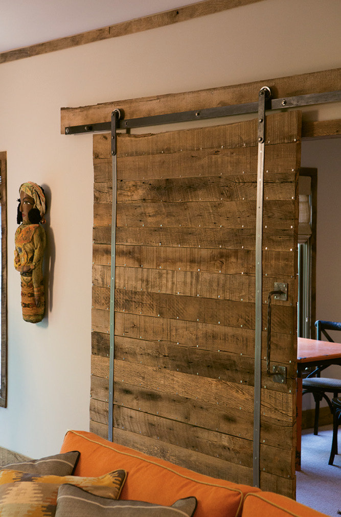 About 1,500 linear feet of wood from the old WNC Livestock Market was used on the trim, sliding door, and mantel in the living room.