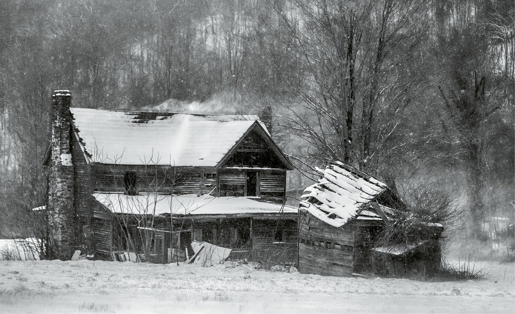 John Haldane, An old, abandoned home along N.C. 197 is lashed by a March snowstorm. Professional category