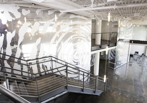 visitors to Hanesbrands Theatre in Winston-Salem find themselves reflected in O'Neal's cymatic mural.