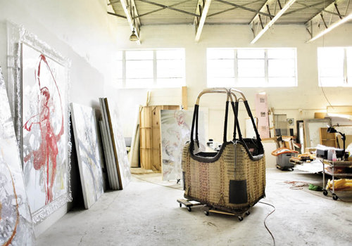 The hot air balloon basket in his studio was a  birthday present, which he will incorporate into an installation.