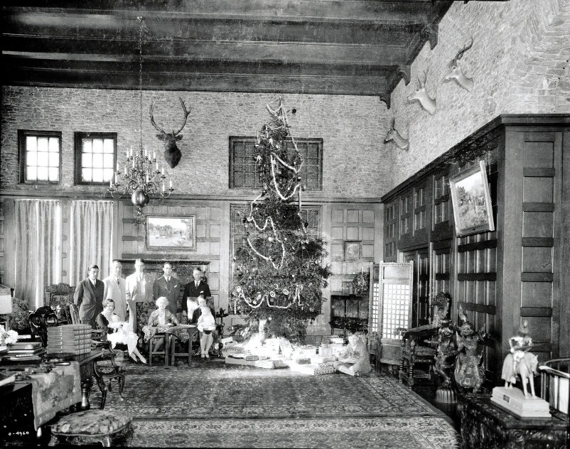 First Family: The Seelys, gathered next to a fittingly grand Christmas tree in one of Overlook's great rooms, lived at the castle until the early 1940s.