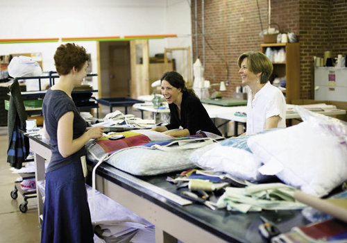 Kelly Gassert, O'Bryan, and Knudson in the Western Carolina Sewing Company room.