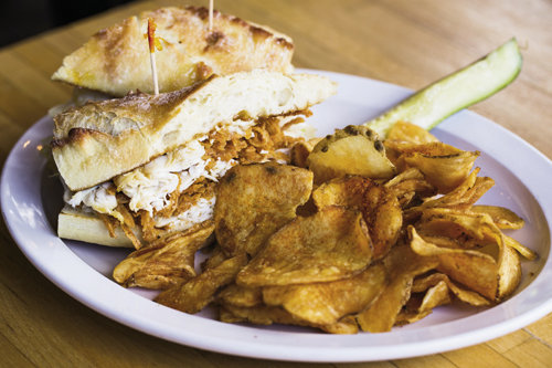 After a day of exploring, fill up on screamin' sandwiches, such as the Truman, made with turkey, peach jam, and blue cheese, from The Secret Sandwich Society, or a creative specialty pizza from Pies & Pints.
