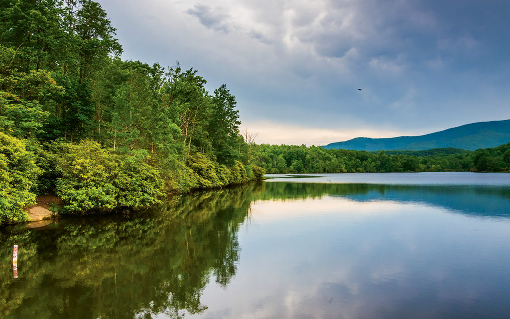 Julian Price Memorial Park and lake, located at Blue Ridge Parkway milepost 297, sits on 4,200 acres at the foot of Grandfather Mountain. Explore the area via an easy trail that encircles the lake, or rent a canoe or kayak to get out on the water.