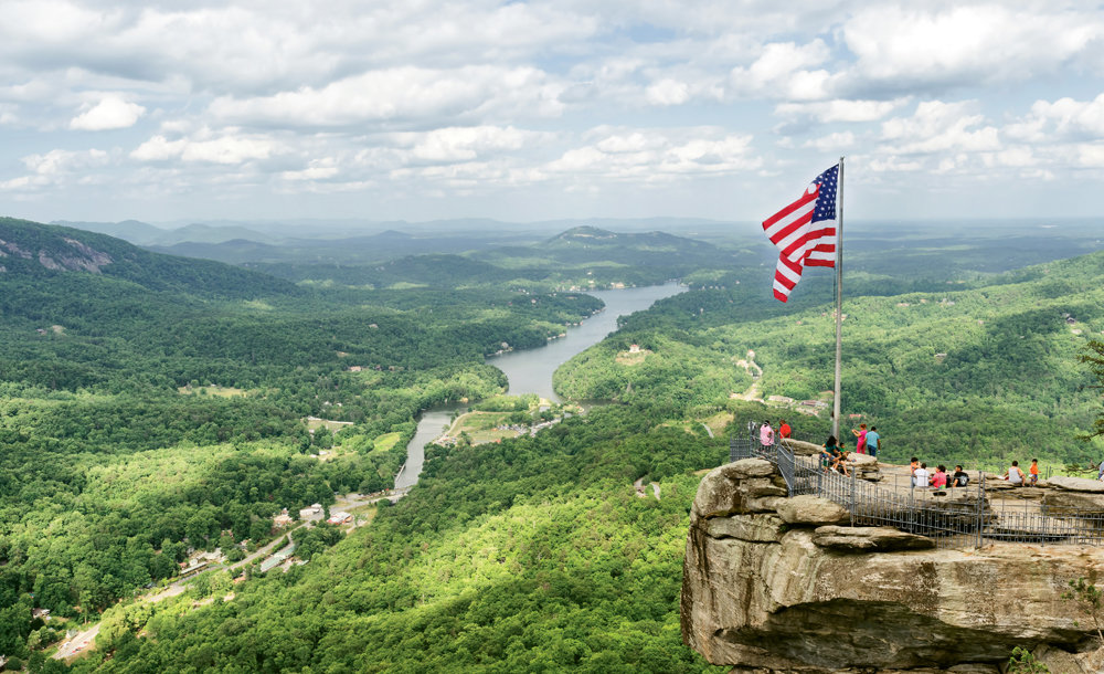 Stone Sentinel: Iconic Chimney Rock stands 2,280 feet above the gorge and Lake Lure beyond.