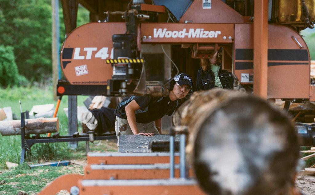Forestry management students grow mushrooms and harvest lumber.