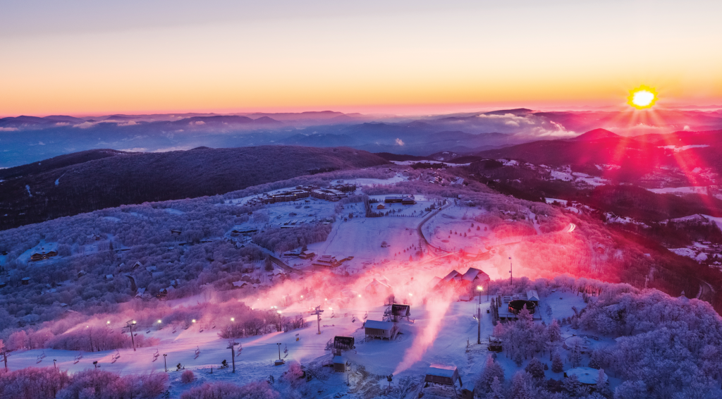 Beech Mountain Resort offers skiing, snowboarding, tubing, ice skating, and places to take a break, including 5506 Skybar, a roundhouse bar on the mountain's summit.