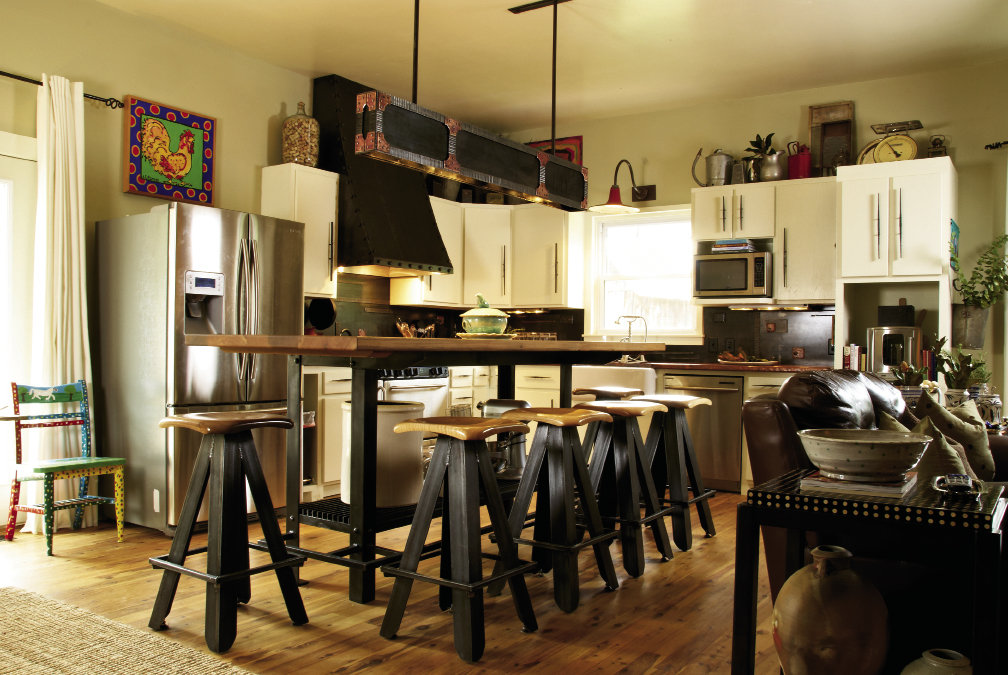 The couple  designed and crafted the large kitchen island and six-foot-long light fixture.