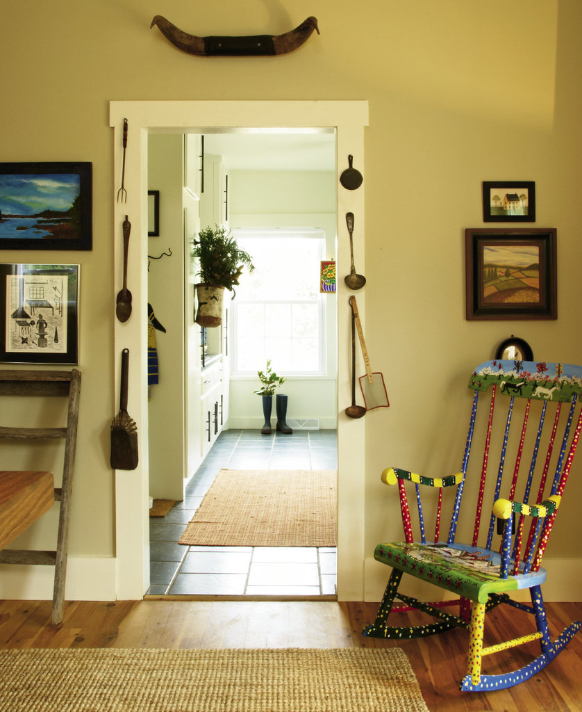 The mudroom, flanked by a rocking chair by folk artist Sam McMillan, was once the summer kitchen.