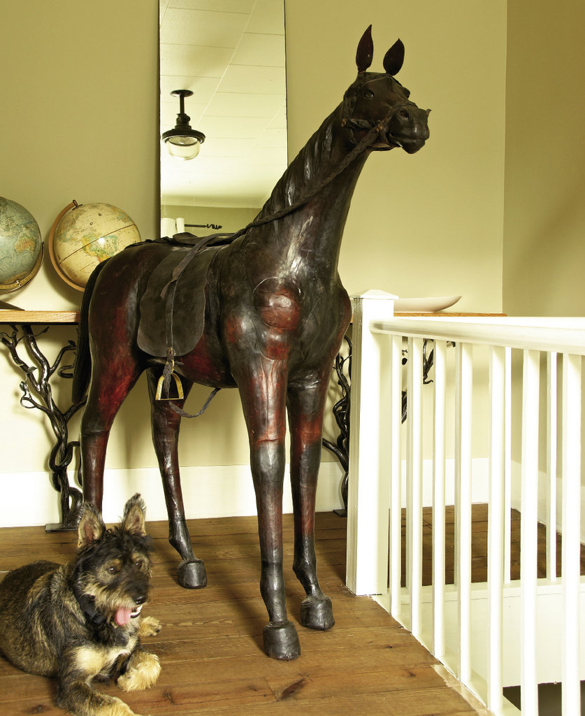The couples's dog, Chuck, has befriended a leather horse that stands outside the guest bedrooms.