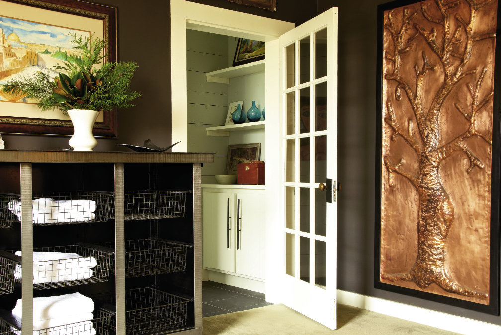 Like most old homes, the farmhouse lacked storage space, so Dean and Lynn designed and constructed a bank of open shelves for clothing and linens.