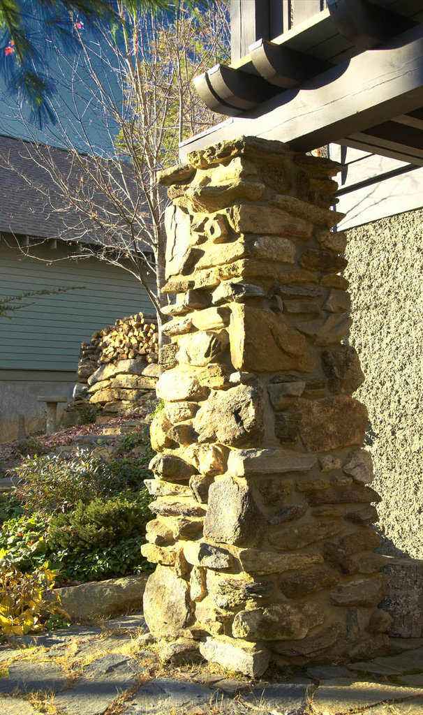The stone pillars that support the balconies feature stonework inspired by the Grove Park Inn.